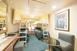 Inside Quad Cabin with Single Beds
