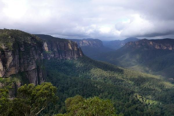 Clouds hang over the lush Blue Mountains of New South Wales, Australia