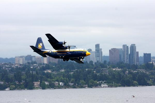 A Blue Angels plane flies over Lake Washington in Bellevue, Washington