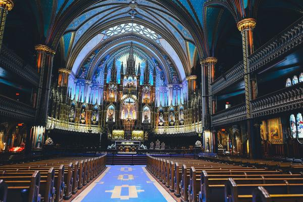 Light shines through the stained-glass windows in the Basilique Notre Dame de Montreal in Ville-Marie, Canada