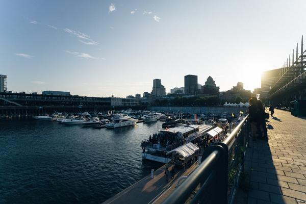Boats are docked in the harbour at the Old Port of Montreal in Ville-Marie, Canada