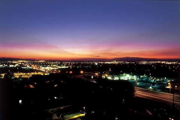 The purple night sky blankets the illuminated city of Lancaster, California