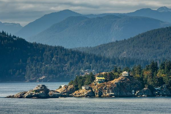 Houses sit perched on the edges of cliffs near Port Hardy on Vancouver Island, Canada