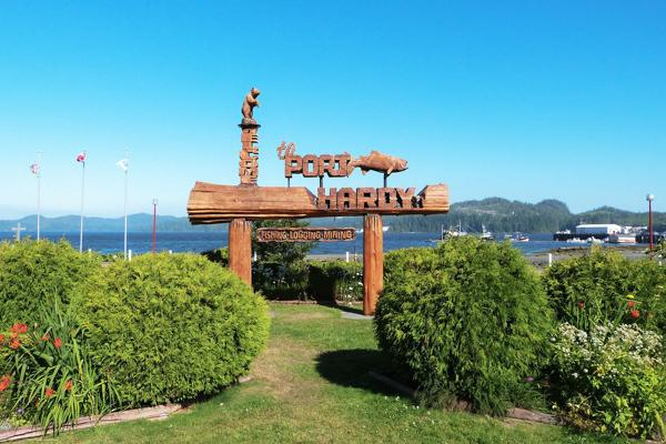 A welcome sign to Port Hardy, Canada portraying a bear and a fish