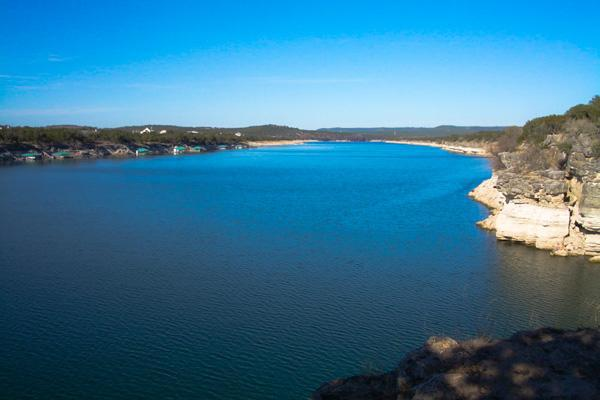 The water of Lake Travis lies undisturbed outside of Round Rock, Texas