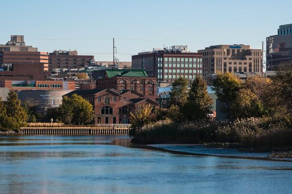 The calm blue waters of the Delaware River flow through the city of Wilmington, Delaware