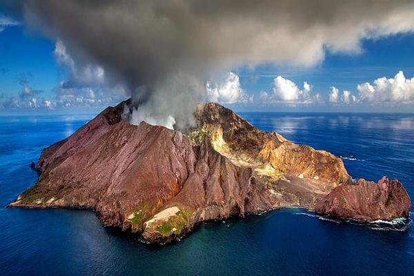 Smoke billows from the top of White Island, a volcanic island near Tauranga, New Zealand